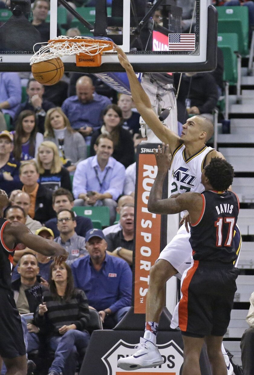 Utah Jazz center Rudy Gobert (27) dunks the ball against Portland Trail Blazers forward Ed Davis (17) in the second quarter during an NBA basketball game Wednesday, Nov. 4, 2015, in Salt Lake City. (AP Photo/Rick Bowmer)