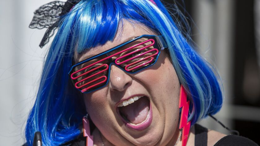 Sandra Martin dresses in '80s garb during the 2018 Like Totally Festival at Huntington State Beach. The day-long series of concerts was to return Saturday but has been canceled, the festival said.