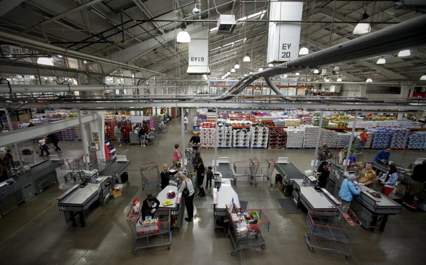 The bare-bones interior doesn't deter shopping -- and employees are valued by paying more than the typical retail worker.
