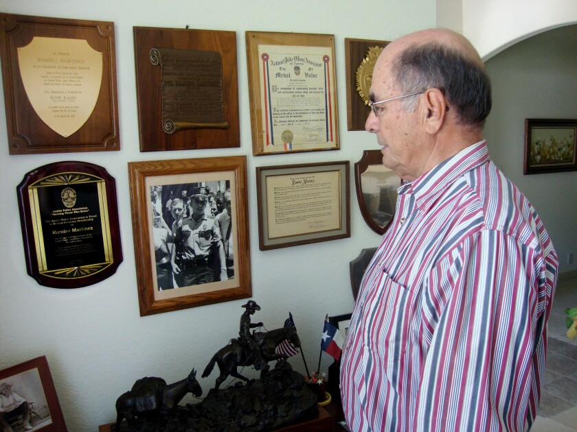 "Former Austin police Sgt. Ramiro ""Ray"" Martinez has several awards for bravery on the wall of his home."