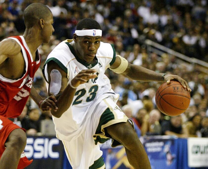 St. Vincent St. Mary's LeBron James drives against Mater Dei's D.J. Strawberry during a game at Pauley Pavilion.