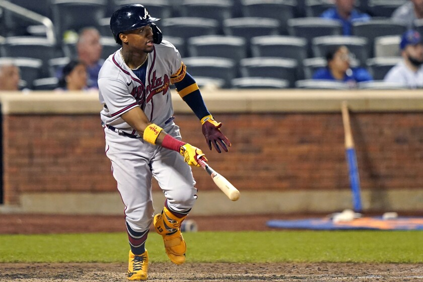 Atlanta Braves' Ronald Acuña Jr. watches his fifth-inning, solo home run off New York Mets relief pitcher Miguel Castro (50) in the second baseball game of a doubleheader, Monday, June 21, 2021, in New York. (AP Photo/Kathy Willens)