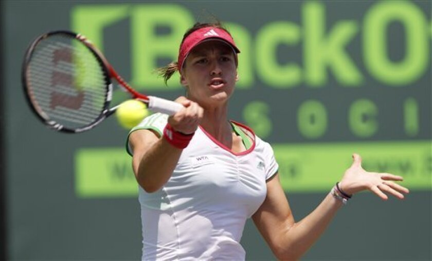 Andrea Petkovic, of Germany, returns to Maria Sharapova at the Sony Ericsson Open tennis tournament in Key Biscayne, Fla., Thursday, March 31, 2011. (AP Photo/Alan Diaz)
