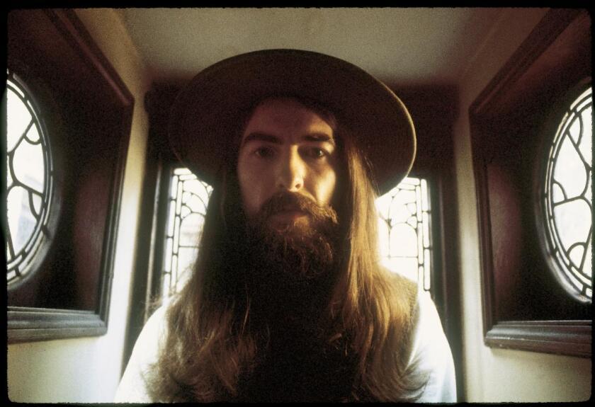 George Harrison wearing a hat