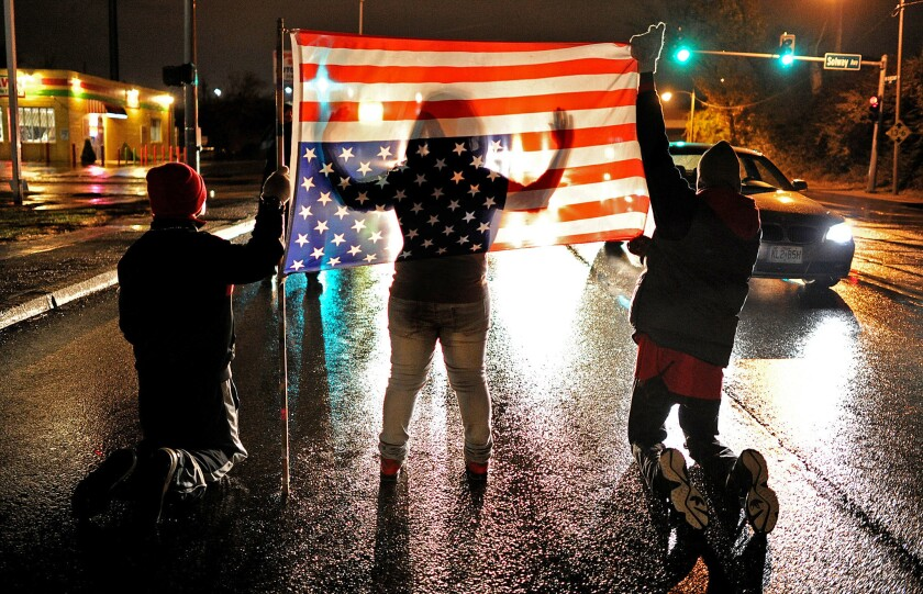 Demonstrators partially block West Florissant Avenue in Ferguson, Mo., on Nov. 22.