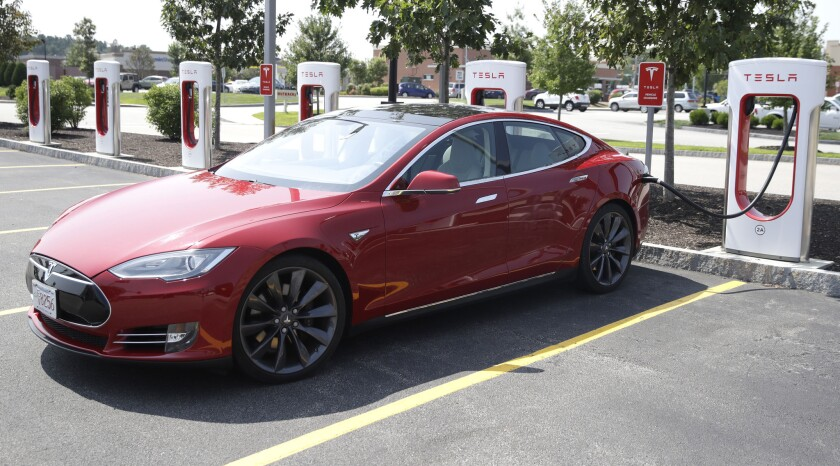 A Tesla Model S, like the one pictured here, appeared to be self-operating through a driver assist feature on a California highway Friday while the man behind the wheel was allegedly passed out drunk.