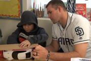 Padres give presents to homeless children at the Monarch School