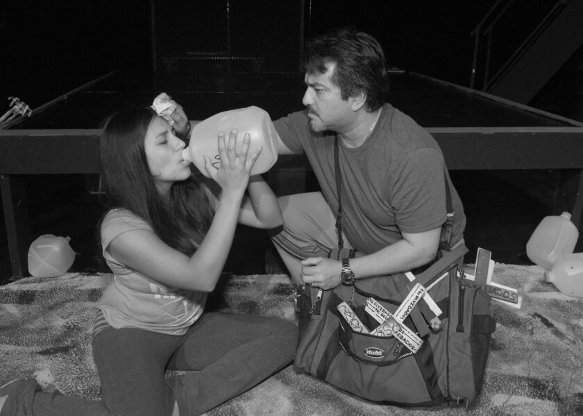 """Alix Mendoza and Dave Rivas in the Teatro Máscara Magica production of Josefina Lopez's """"Detained in the Desert."""""""