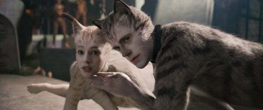 """Francesca Hayward is Victoria and Robbie Fairchild is Munkustrap in Tom Hooper's movie adaptation of """"Cats."""""""