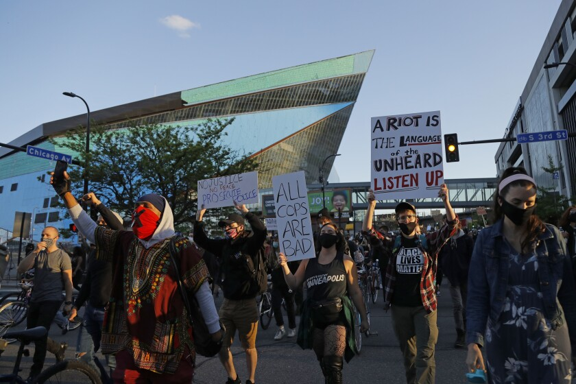 Protesters gather outside the Minnesota Vikings' stadium on May 29 in Minneapolis.