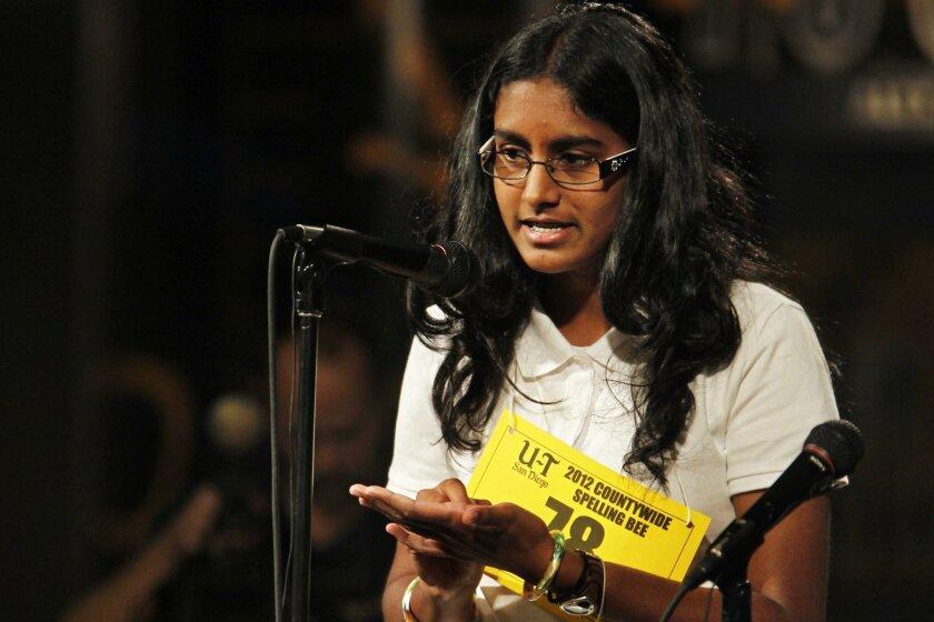 "Snigdha Nandipati of Francis Parker School spells the word ""gobemouche"" to win."