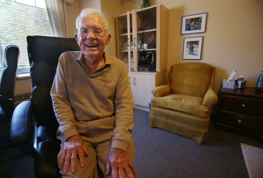 Dr. Charles Steffen in the office of the two-bedroom apartment he shares with his wife in the memory-care unit at Aegis of Shadowridge. His wife, Mary Alice, has Alzheimer's but he does not.