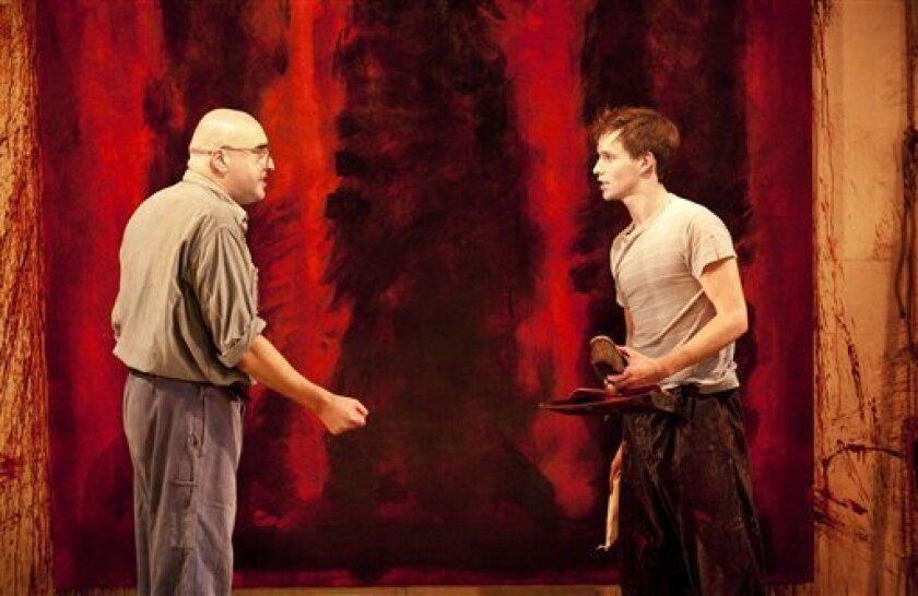 Alfred Molina portrays Mark Rothko, left, and Eddie Redmayne portrays Ken in a scene.