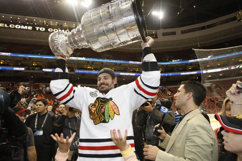 FILE - In this June 9, 2010, file photo, Chicago Blackhawks defenseman Brent Sopel lifts the Stanley Cup after the Blackhawks beat the Philadelphia Flyers 4-3 in overtime to win Game 6 of the NHL Stanley Cup hockey finals in Philadelphia. The former NHL defenseman is drawing upon the lifelong challenges he faced in dealing with dyslexia to help others(AP Photo/Kathy Willens, File)