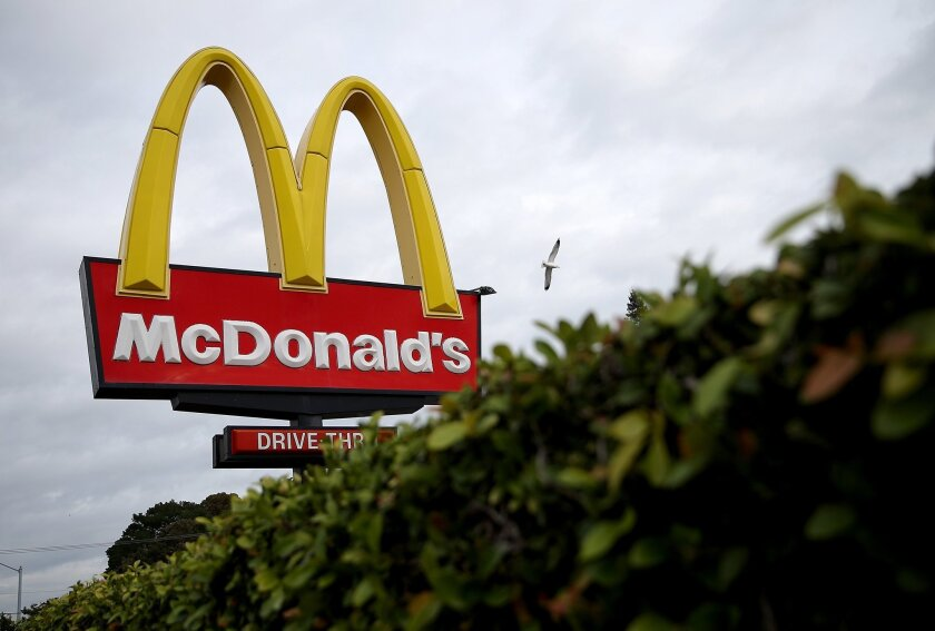 Employees at an Oakland McDonald's went on strike Tuesday after four workers and their family members tested positive for COVID-19.