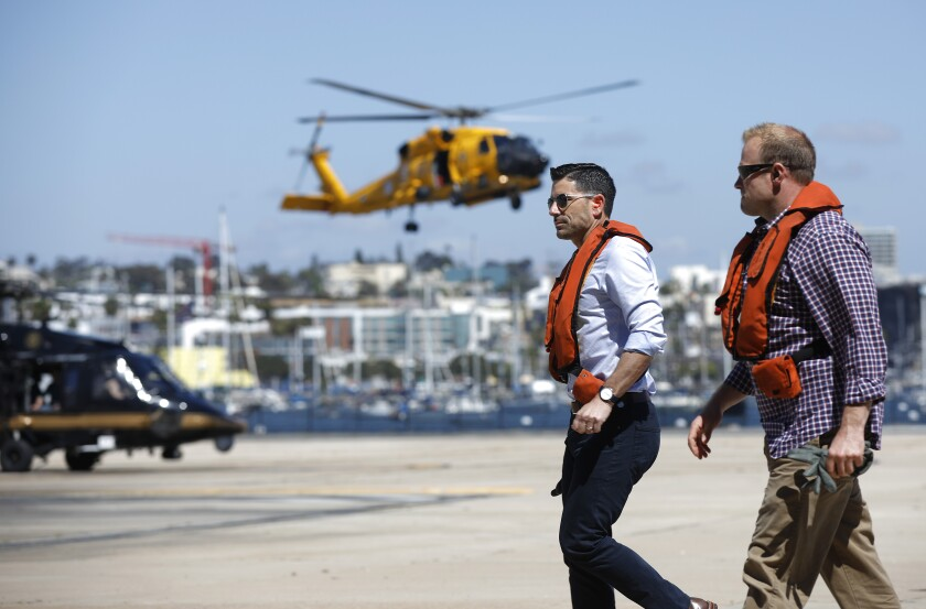 Chad F. Wolf, acting Secretary of Homeland Security, left, arrives at the U.S. Coast Guard Sector San Diego after taking a helicopter tour of the San Diego Sector border region on May 13, 2020.