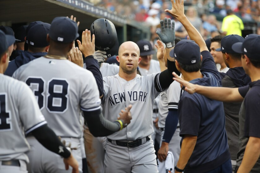 FILE - In this Sept. 10, 2019, file photo, New York Yankees' Brett Gardner celebrates his solo home run in the second inning of a baseball game against the Detroit Tigers, in Detroit. Outfielder Brett Gardner is staying with the New York Yankees after the best offensive season of his career, agreeing to a one-year contract that guarantees $12.5 million, a person familiar with the negotiations told The Associated Press. The person spoke on condition of anonymity Thursday, Dec. 12, 2019, because the agreement had not be announced. (AP Photo/Paul Sancya, File)