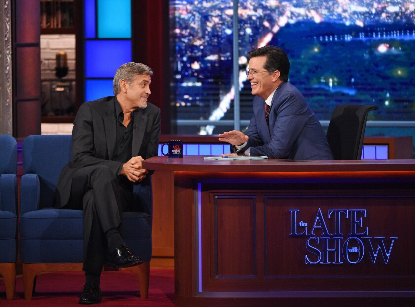 """Actor George Clooney stops by during the premiere of """"The Late Show with Stephen Colbert."""""""