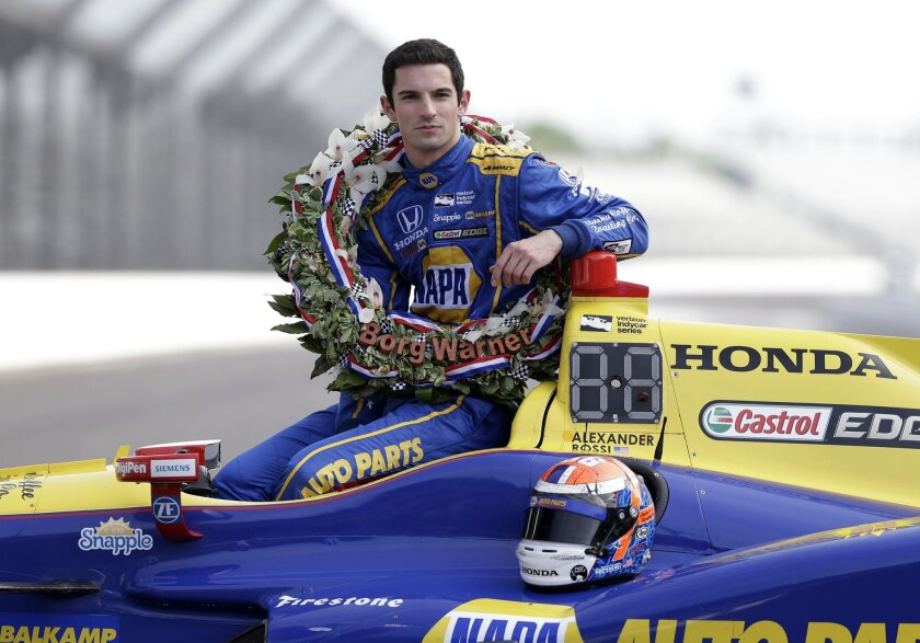 Indianapolis 500 champion Alexander Rossi poses during the traditional winners photo on the start/finish line at Indianapolis Motor Speedway in Indianapolis, Monday, May 30, 2016. Rossi won the 100th running of the Indianapolis 500 auto race on Sunday. (AP Photo/Michael Conroy)