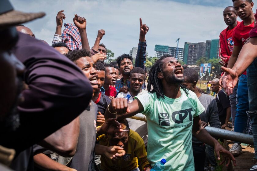 People react at Meskel Square in Addis Ababa, Ehiopia, to protest on September 17, 2018 against the killing of 23 people and displacment of residents in Burayu town over the weekend. - Ethnic violence in Ethiopia left 23 people dead at the weekend, state media reported on September 17, 2018, as protests against the killings gripped the capital Addis Ababa where an angry crowd gathered in the city centre. (Photo by Maheder HAILESELASSIE TADESE / AFP) (Photo credit should read MAHEDER HAILESELASSIE TADESE/AFP/Getty Images)