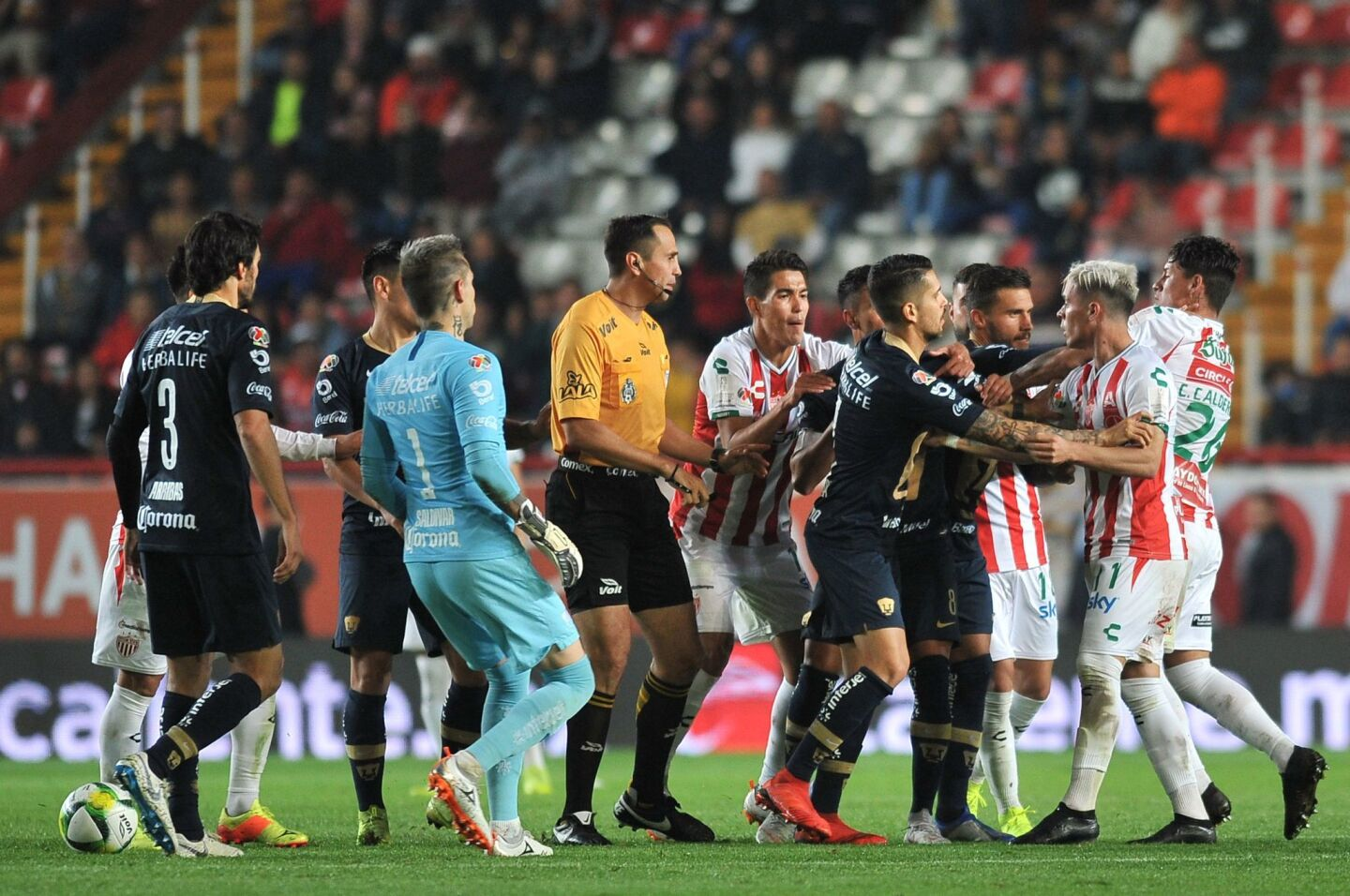 Necaxa's players argue with Pumas's players during the Mexican Clausura 2019 tournament football match between Necaxa and Pumas UMAN at Victoria Stadium in Aguascalientes, Mexico, on January 12, 2019. (Photo by VICTOR CRUZ / AFP)VICTOR CRUZ/AFP/Getty Images ** OUTS - ELSENT, FPG, CM - OUTS * NM, PH, VA if sourced by CT, LA or MoD **