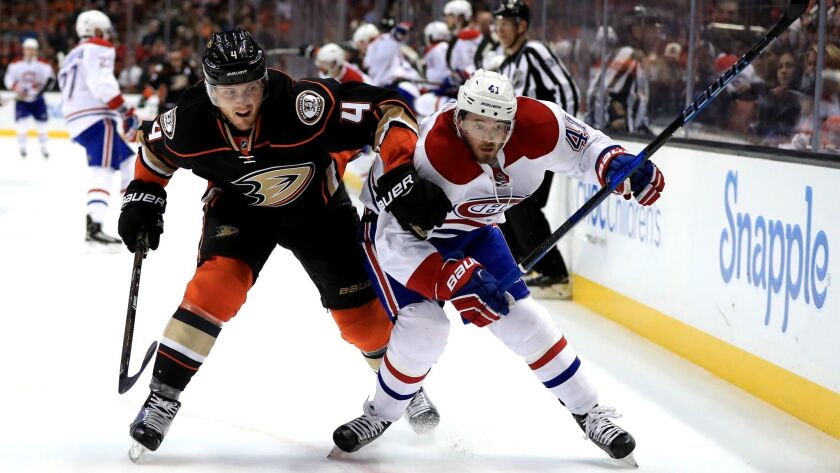 The Ducks' Cam Fowler pushes Montreal's Paul Byron on Nov. 29 at the Honda Center.