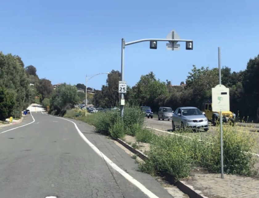The median separating Azure Coast Drive (left) from La Jolla Parkway is full of weeds and bare patches.