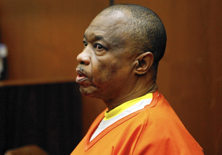 Lonnie Franklin Jr., who authorities say is the Grim Sleeper serial killer, answers questions from the witness stand in January 2014. His trial, which has been repeatedly postponed, is set to start in October.
