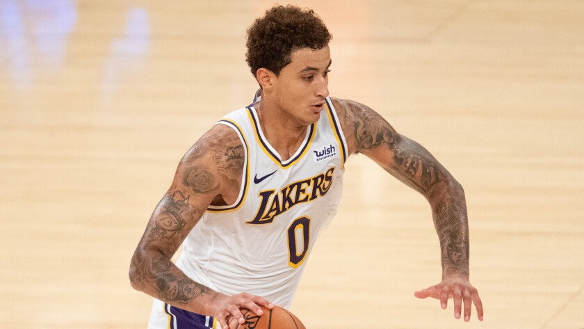 Lakers forward Kyle Kuzma drives to the basket during a preseason game against the Clippers on Dec. 11.