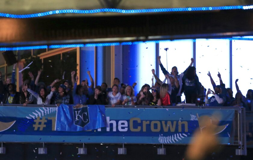 Kansas City Royals fans celebrate at the end of game five of the World Series in the Power and Light District Kansas City, Mo., Sunday, Nov. 1, 2015. (AP Photo/Orlin Wagner)