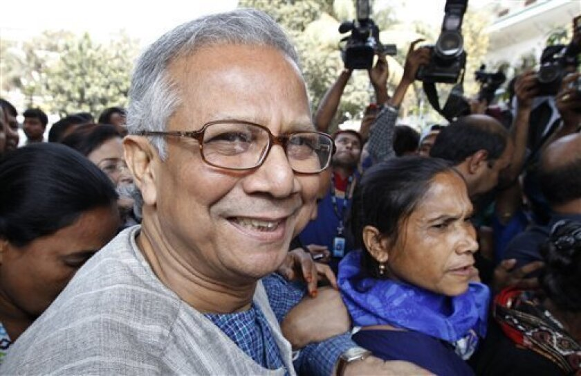 FILE - In this March 3, 2011 file photo, Bangladeshi Nobel laureate Muhammad Yunus smiles as he arrives at the High Court in Dhaka, Bangladesh before launching a court case to reverse a Bangladesh government's order dismissing him as the head of the microfinance bank. Yunus lost his final court appeal Tuesday, April 5, 2011, 2011 to remain in control of the pioneering microlending bank he founded three decades ago to lift Bangladeshis out of poverty. (AP Photo/Zia Islam, File)