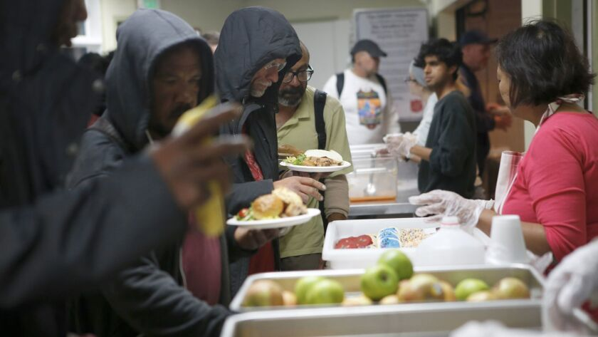 People stand in line for a meal at the Salvation Army shelter in Hollywood.