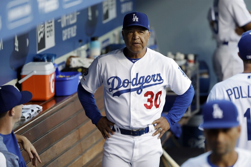 Dodgers manager Dave Roberts in the dugout during a game against the Angels on July 23, 2019.