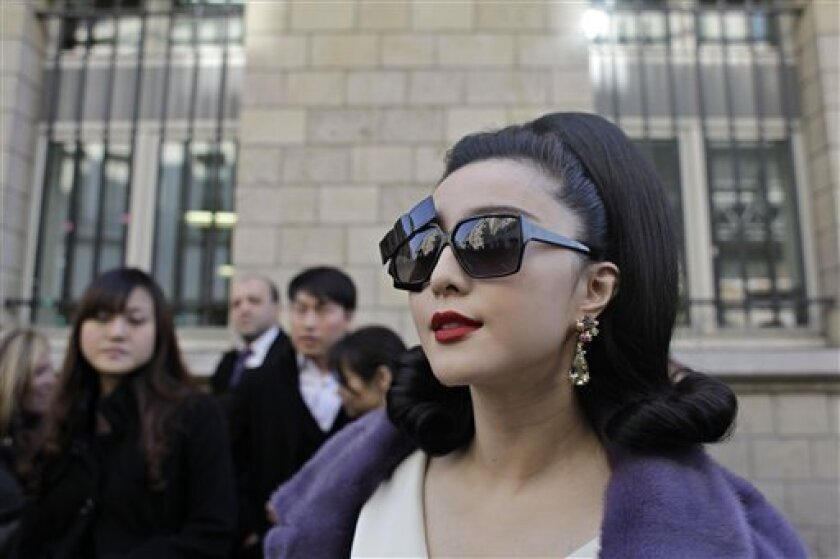 Chinese actress Fan Bing Bing arrives at the Dior's fall-winter 2011-12 ready-to-wear collection in Paris, Friday, March 4, 2011. (AP Photo/Thibault Camus)