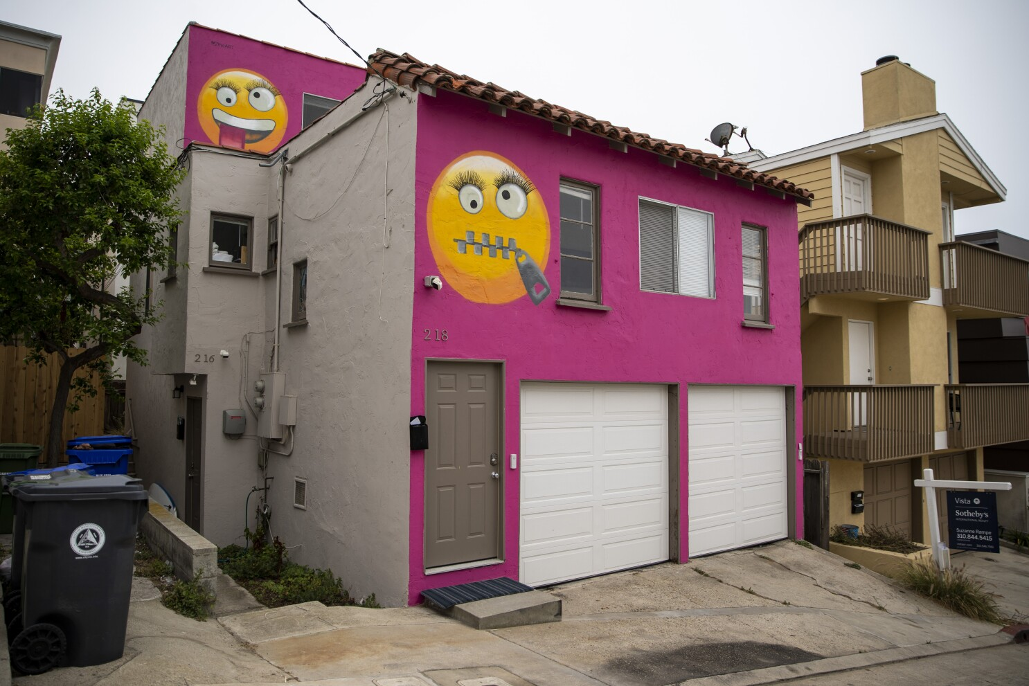 A pink house with giant emojis is not a municipal crisis