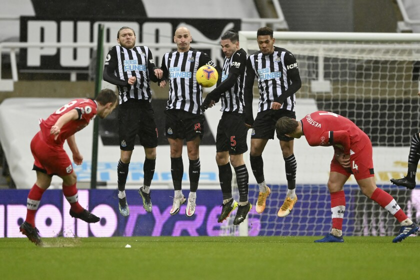 Southampton's James Ward-Prowse, left, scores his side's 2nd goal on a free-kick, during the English Premier League soccer match between Newcastle United and Southampton, at St. James' Park Stadium in Newcastle, England, Saturday, Feb. 6, 2021. (Stu Forster, Pool via AP)