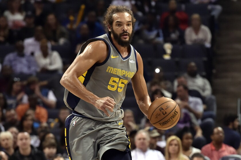 Memphis Grizzlies center Joakim Noah brings the ball up the court March 23, 2019.