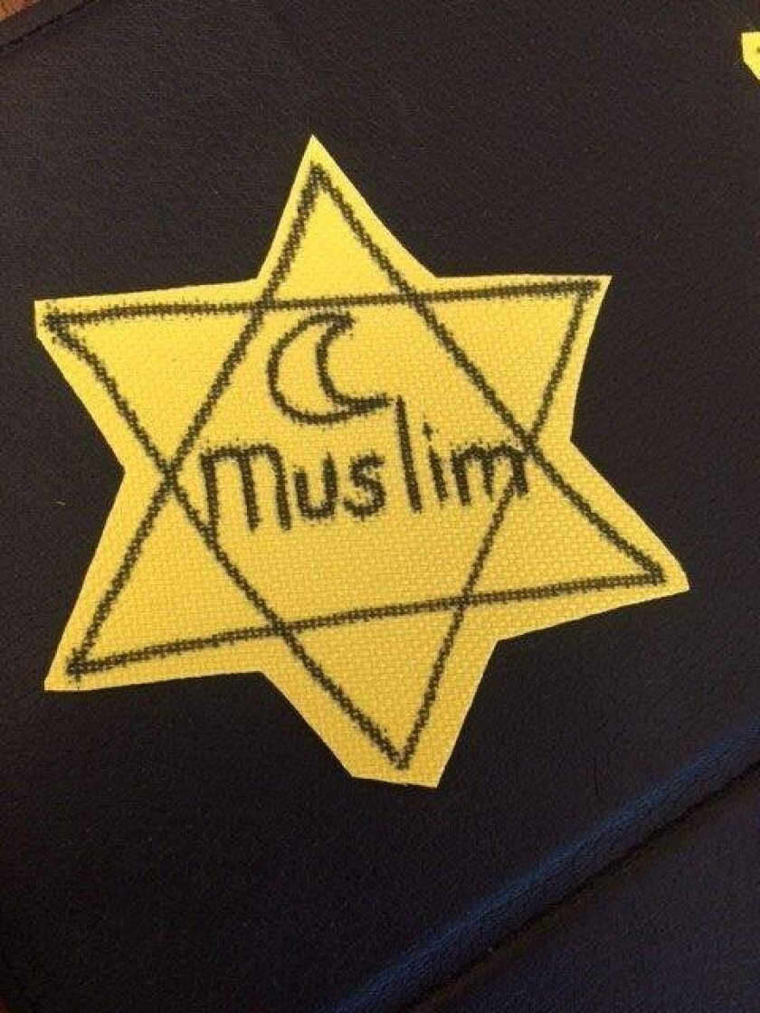 """Students in Associate Professor Bahar Davary's Dept. of Theology and Religious Studies class wearing yellow Stars of David with the word """"Muslim"""" written on them at the University of San Diego. Photos courtesy Bahar Davary via TimesOfSanDiego.com"""