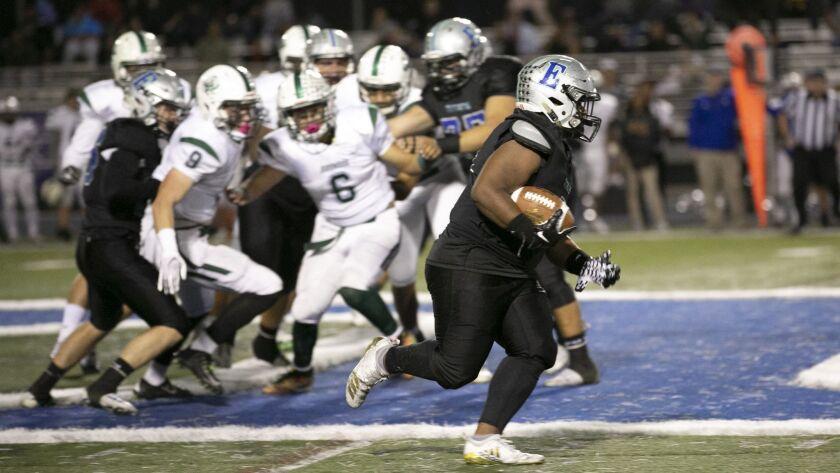 3064475_sd_sp_preps_terrones_1110_ Oceanside at Eastlake in San Diego Section Division I high school football quarterfinal game.