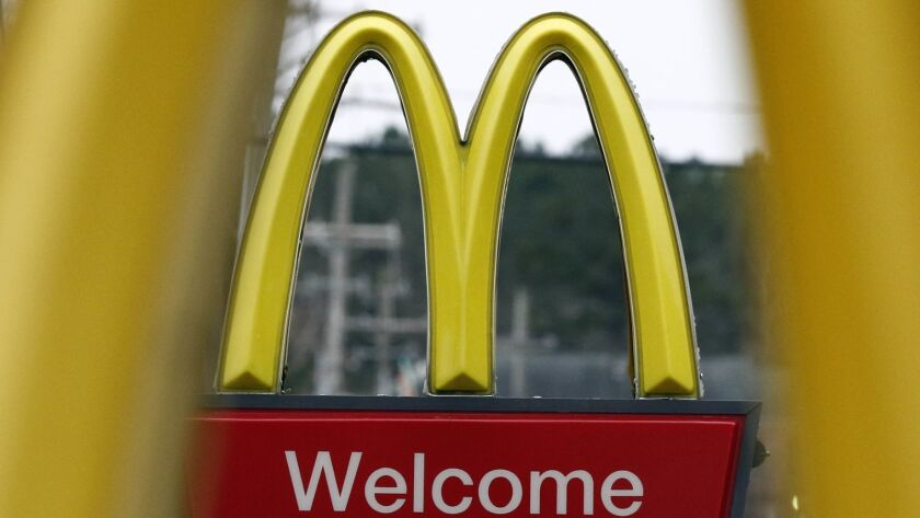 FILE- In this Feb. 15, 2018, file photo, shows a sign for a McDonald's restaurant in Brandon, Miss.