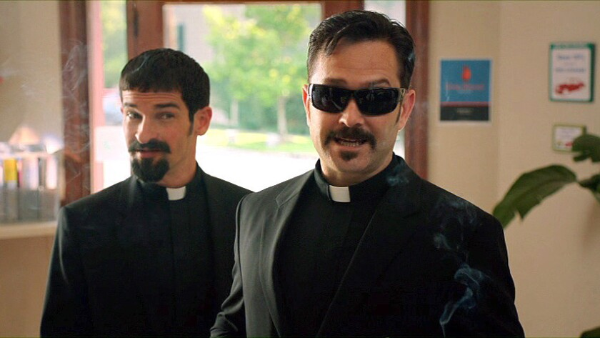 """Co-directors and co-stars Ben Garant and Thomas Lennon star as exorcists dispatched from the Vatican to investigate a possible possession in the movie """"Hell Baby."""""""