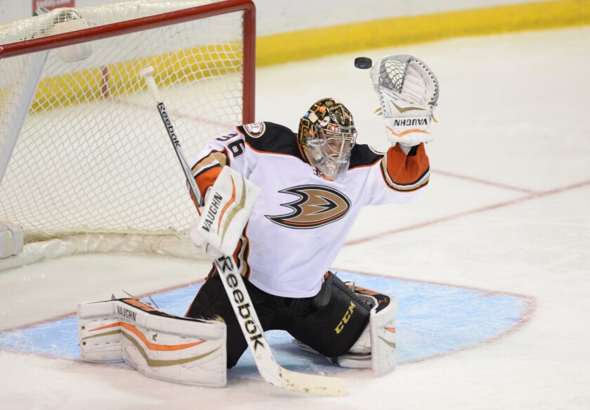 Anaheim goalie John Gibson reaches for the puck in a game against the Blues in St. Louis on Oct. 30, 2014.