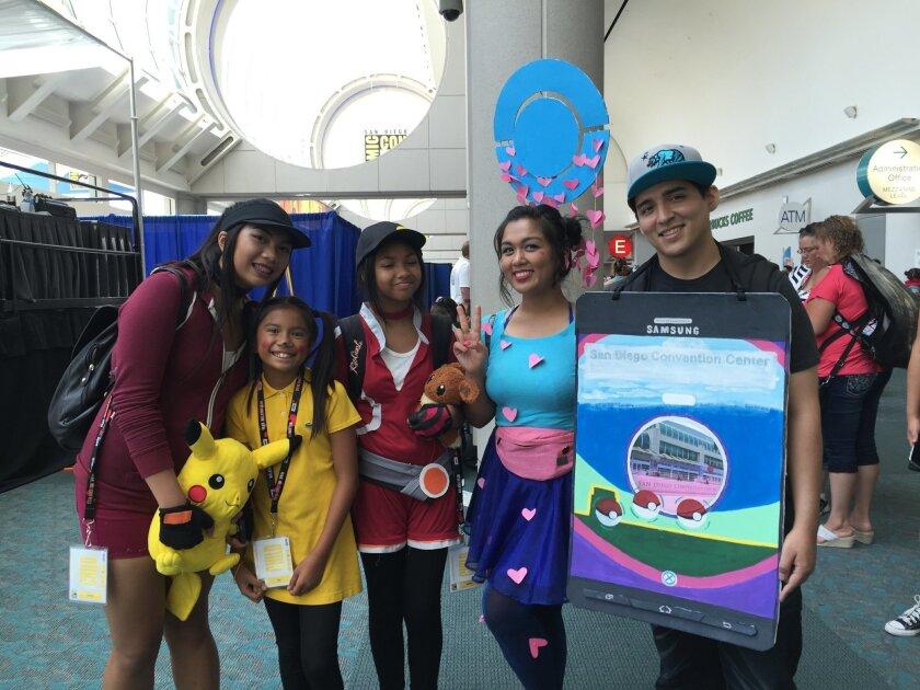Kristen Alexa, Kiara Alexa, Annabelle Doran, Julianne Doran and Pedro Zea pose in their Pokemon Go costumes at Comic-Con Thursday.