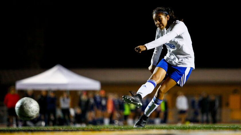 Eastlake's Katherine Diaz shoots the winning penalty kick against Steele Canyon to secure the Open Division title for the Titans last week.