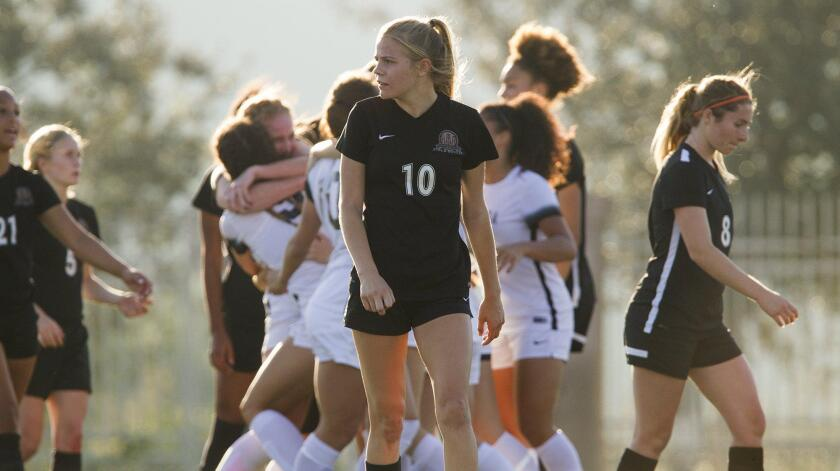Huntington Beach High's Summer Stewart (10) and teammates react after JSerra goes up 1-0 during the first half in the CIF Southern California Regional Division 1 championship game in San Juan Capistrano on Saturday.