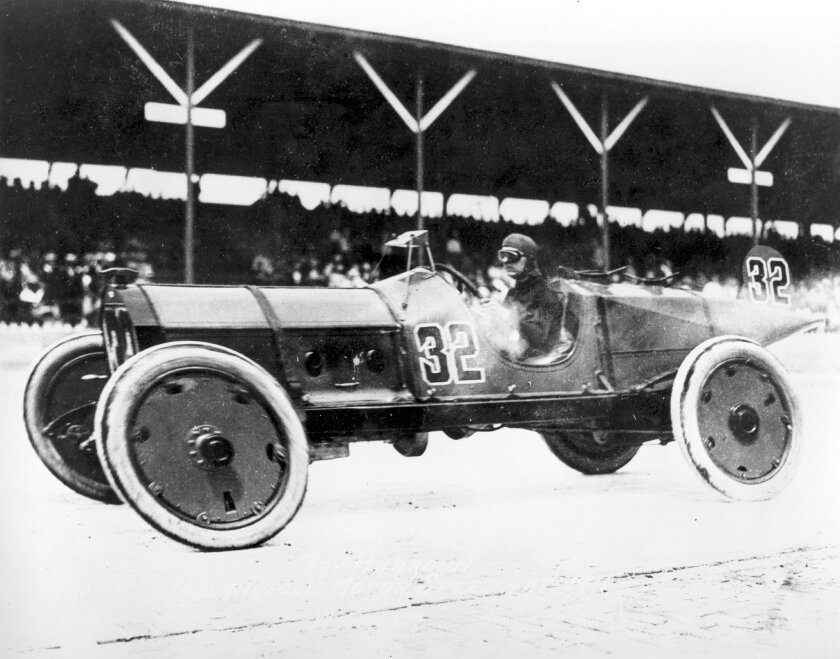 FILE - This May 30, 1911, file photo shows Ray Harroun driving his No. 32 Marmon Wasp race car to victory in the inaugural Indianapolis 500 auto race at the Indianapolis Motor Speedway, in Indianapolis, Ind. (AP Photo/File)