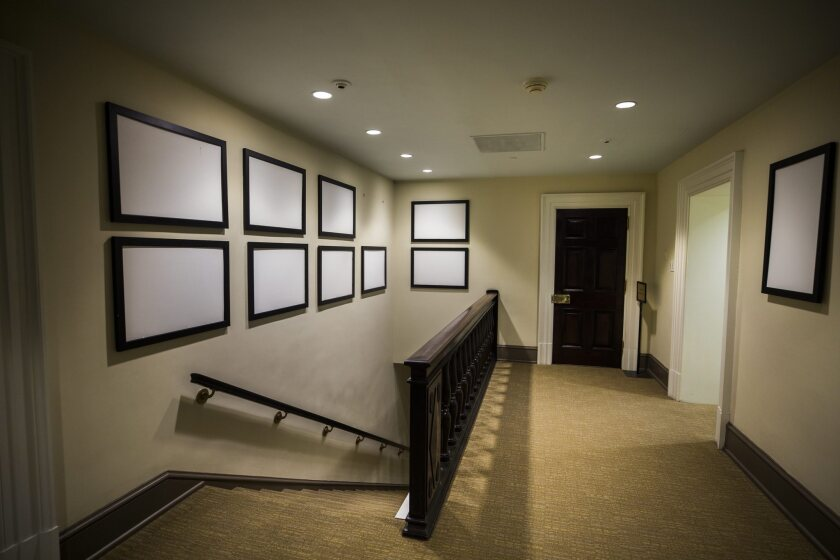 Picture frames that once displayed photographs of President Barack Obama and his family now sit empty in the West Wing of the White House on Jan. 19, 2017.