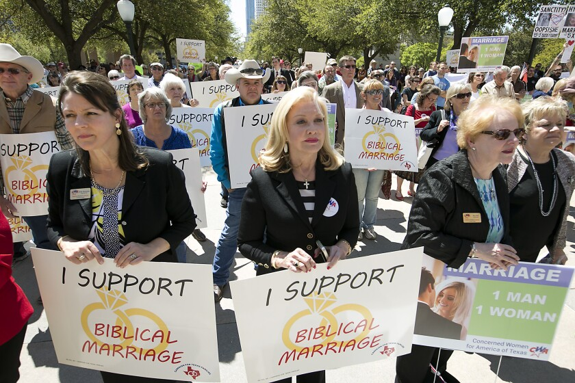 Demonstrators rally outside the state Capitol in Austin, Texas, in March to show their support for laws defining marriage as a union between a man and a woman.