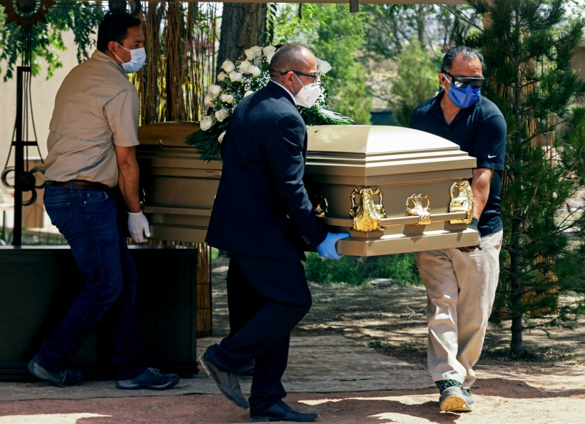 Funeral parlor workers transport the body of a COVID-19 victim in Ciudad Juárez, Mexico, on May 15.
