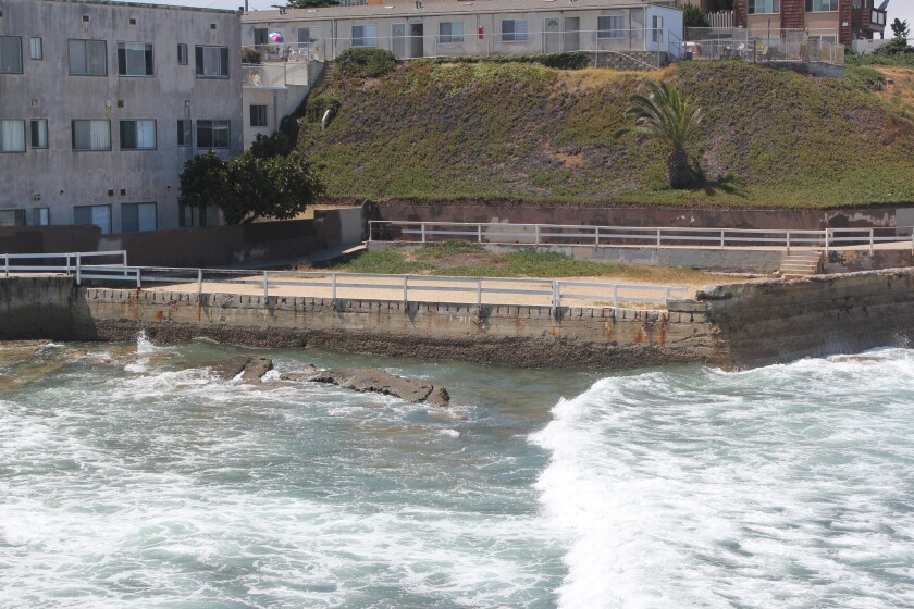 The former saltwater pool known as the Plunge, now filled with sand, is at the foot of the Silver Spray Apartments.